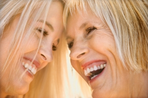 Mom and daughter laughing.